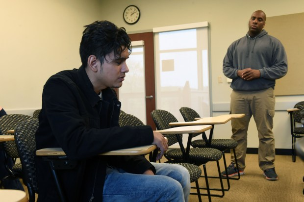 St. Paul Police Officer A. Buckley, right, talks with actor Sebastian Molina, playing the part of a college student with traumatic brain injury, during a crisis intervention team training session which the St. Paul Police Department and Hamline University are collaborating on, April 19, 2017 in St. Paul. Molina is a University of St. Thomas theater student taking part in a theater co-op with Hamline University. Scott Takushi / Pioneer Press