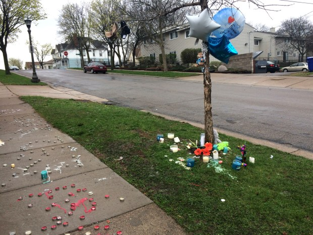 Candles, balloons and stuffed animals mark the spot on Tuesday, April 18, 2017, on St. Albans Street between Fuller and Central avenues in St. Paul where a candlelight-vigil was held Monday for a man shot and killed that day. (Mara H. Gottfried /Pioneer Press)