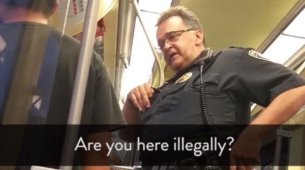 An encounter between a Metro Transit police officer and a rider was recorded May 14, 2017, on the Blue Line light rail train in Minneapolis, according to a Facebook post. (Facebook video screengrab)