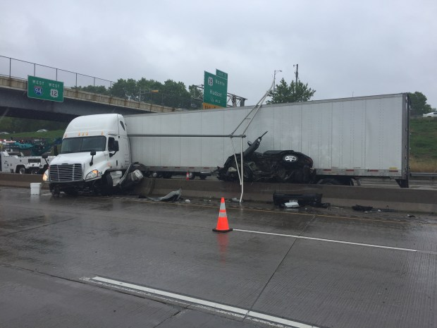 The driver of a car pinned between a semitrailer and a median barrier was seriously injured Saturday, May 20, 2017, on Interstate 94 west of Hudson, Wis. (Courtesy of Wisconsin State Patrol)