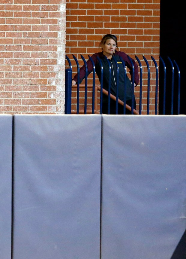Minnesota head coach Jessica Allister watches from outside the stadium after being ejected in the second inning during an NCAA college softball tournament regional game against New Mexico State, Saturday, May 16, 2015, in Tucson, Ariz. (AP Photo/Rick Scuteri)