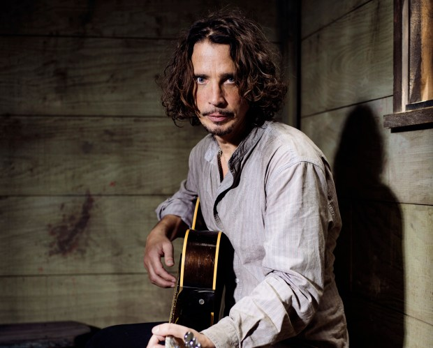 In this July 29, 2015 photo, Chris Cornell plays guitar during a portrait session at The Paramount Ranch in Agoura Hills, Calif. Cornell, 52, who gained fame as the lead singer of the bands Soundgarden and Audioslave, died at a hotel in Detroit and police said Thursday, May 18, 2017, that his death is being investigated as a possible suicide. (Photo by Casey Curry/Invision/AP)