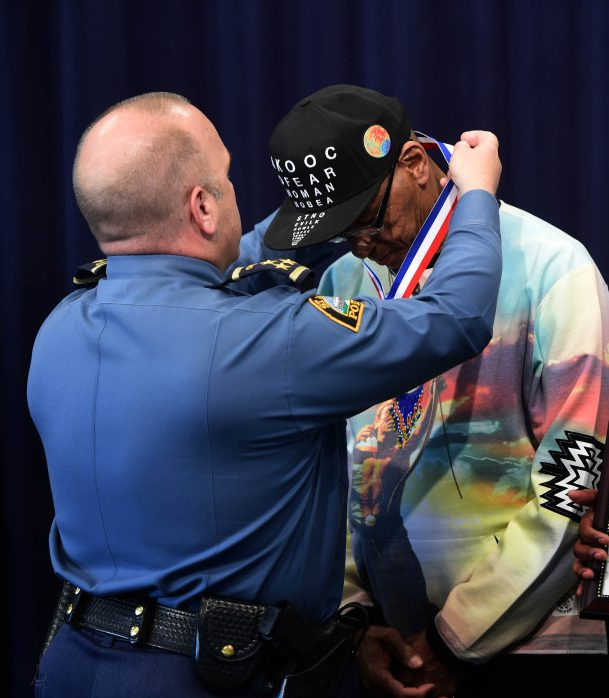 Bill Boursaw, left, received the Chief's Award for Valor from St. Paul Police Chief Todd Axtell in St. Paul, Tuesday, May 30, 2017. The two civilians helped save the life of a young woman who was attempting to jump off the Dale Street Bridge over Interstate-94. Scott Takushi Pioneer Press