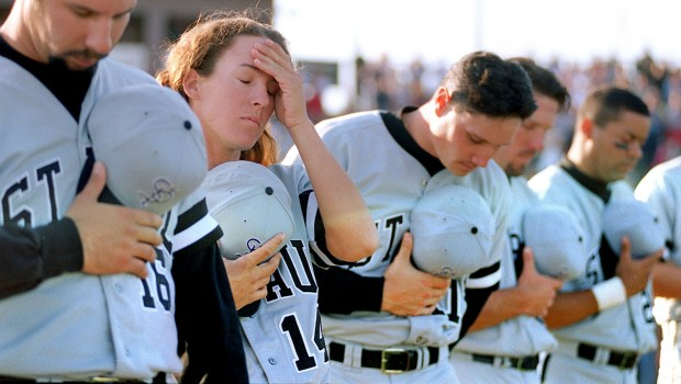 St. Paul Saints pitcher Ila Borders wipes her brow as she stands with Saints teammates during the National Anthem before her first professional baseball game against the Sioux Falls Canaries in Sioux Falls, S.D. on Friday, May 30, 1997. Borders did not pitch in the game. (Bill Alkofer / Pioneer Press)