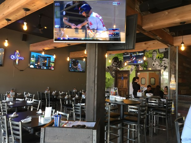 The interior of La Costa in St. Paul includes several murals and plenty of televisions for watching sports. (Jess Fleming / Pioneer Press)