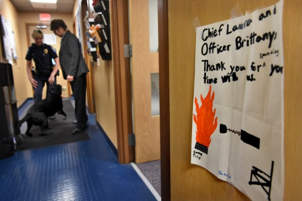 A thank you note from Jenna Ellis to Bayport Police Officer Brittany Lepowsky, left, and Police Chief Laura Eastman is taped to a door at the Bayport Police Department as the two get ready to walk across the street to have lunch with Jenna at Anderson Elementary School on April 27, 2017. (Jean Pieri / Pioneer Press)