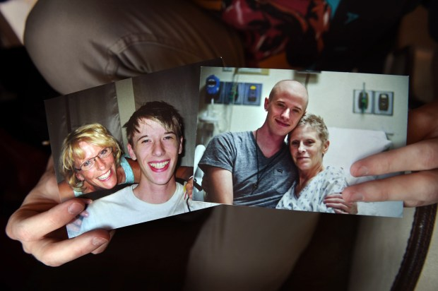 Bo Weber shows photos Thursday, May 11, 2017, of himself taken with his mom, Wendy, in 2009, left, and in the hospital in 2013. He surprised her in the hospital on Mother's Day in 2013 with a shaved head because he donated 12 inches of his hair to Locks of Love. The singer/songwriter wrote and recorded his new album, about his mother's death from ovarian cancer at the age of 50. (Jean Pieri / Pioneer Press)