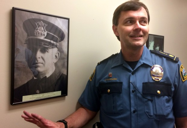 St. Paul Police Cmdr. Jim Falkowski tells the story of his grandfather, St. Paul Officer Joseph Falkey, at police headquarters on Friday, May 5, 2017. Jeff Neuberger, a custodian engineer for the police department, hung about 300 historic photos around the building, including Falkey's. (Mara H. Gottfried / Pioneer Press)