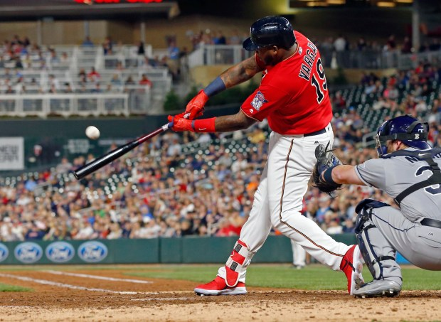 Minnesota Twins' Kennys Vargas hits an RBI-single off Tampa Bay Rays pitcher Chris Archer in the seventh inning of a baseball game Friday, May 26, 2017, in Minneapolis. (AP Photo/Jim Mone)