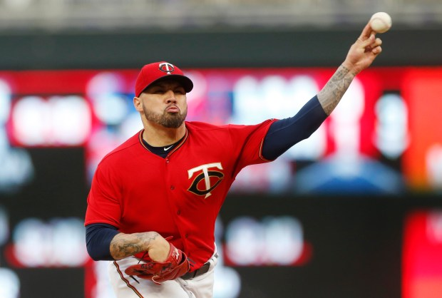 Minnesota Twins pitcher Hector Santiago throws against the Kansas City Royals during the first inning of a baseball game Friday, May 19, 2017, in Minneapolis. (AP Photo/Jim Mone)
