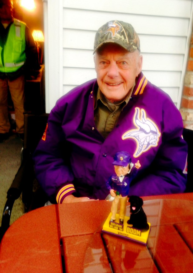Vikings Hall of Fame coach Bud Grant at his garage sale in Bloomington on Thursday, May 18, 2017. Shown with the bobblehead doll he is selling at his garage sale for $150, which depicts Grant along with his beloved hunting dog Boom, who died last year. (Chris Tomasson / Pioneer Press)