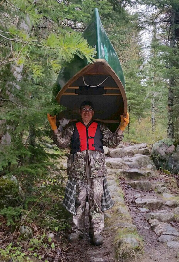 t06.07.17 060817.N.DNT.rescuec Charles Kelley carried his and Scaia's canoe through 10 portages in the BWCAW before they decided to start their three day trip out. Photo by Pamela Scaia