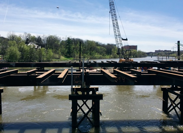 This April 17, 2017, photo shows the construction of the new Park Road Bridge in Iowa City, Iowa. After routine flooding in recent years, the city has started a $40 million project to raise Dubuque Street and the bridge, which takes traffic over the Iowa River near the University of Iowa campus. (AP Photo/Ryan J. Foley)