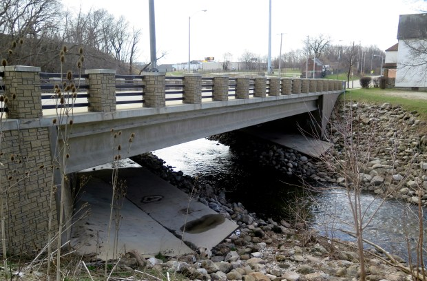 This April 6, 2017 photo shows Milwaukee's South Sixth Street Bridge over the Kinnickinnic River. The Milwaukee Metropolitan Sewerage District raised the bridge to prevent the waterway from backing up amid downpours. It's a technique cities nationwide are using as officials prepare for more intense rainstorms resulting from a warming climate. (AP Photo/Ivan Moreno)
