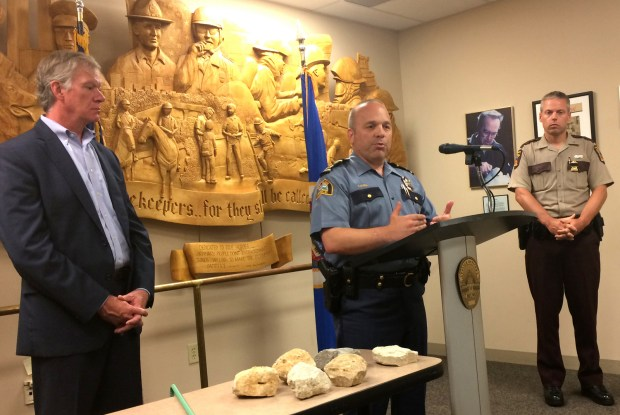 St. Paul police chief Todd Axtell, center — along with Mayor Chris Coleman, left, and Minnesota State Patrol Col. Matt Langer — spoke at a press conference Sunday morning, July 10, 2016, at St. Paul police headquarters about protests the night before in St. Paul. On the table in front of them were rocks and rebar that they said were thrown at officers, injuring 21. (Pioneer Press: Mara Gottfried)