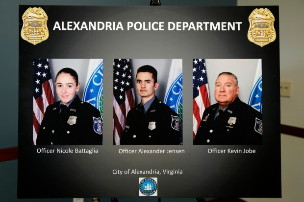 A poster shows images of Alexandria, Va. Police Officers, from left, Nicole Battaglia, Alexander Jensen, and Kevin Jobe, during a news conference at the Police Headquarters in Alexandria, Va., Monday, June 19, 2017, about the June 14 shooting at a baseball field in Alexandria. The three officers were praised by Alexandria Police Chief Michael Brown for their actions during the incident. (AP Photo/Jacquelyn Martin)