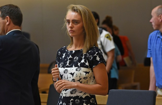 In this Monday, June 12, 2017 photo, Michelle Carter stands as court is in recess at the end of the day at her trial in Taunton, Mass. Carter is charged with involuntary manslaughter for encouraging Conrad Roy III to kill himself in July 2014. The judge is set to issue a verdict in the case on Friday. (Faith Ninivaggi/The Boston Herald via AP, Pool)