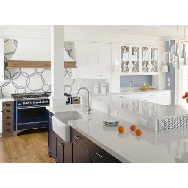 The dramatic counters in this kitchen resemble natural stone, but are made of quartz composite.http://www.homedepot.com/p/Silestone-2-in-Quartz-Countertop-Sample-in-Lyra-SS-Q0190/203674448