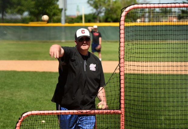Coach Adam Hunkins pitches during batting practice as the Central High School varsity baseball team works out at Toni Stone Field, a city-owned ballfield, Wednesday, May 31, 2017. A battle is heating up between athletic officials at Central High School and the city over use of city-owned fields including Toni Stone, the jewel of all the city's ballfields. (Scott Takushi / Pioneer Press)