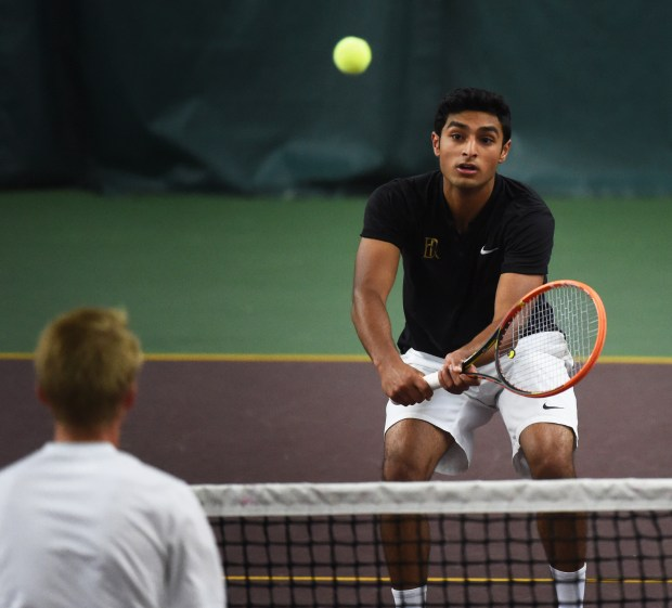 East Ridge's Nitin Venkatesh returns a shot against Wayzata's Matthew Hagan during a doubles match of the Class 2A team semifinals during the State Boys' Tennis Tournament at Baseline Tennis Center in Minneapolis on Wednesday, June 7, 2017. (Scott Takushi Pioneer Press)