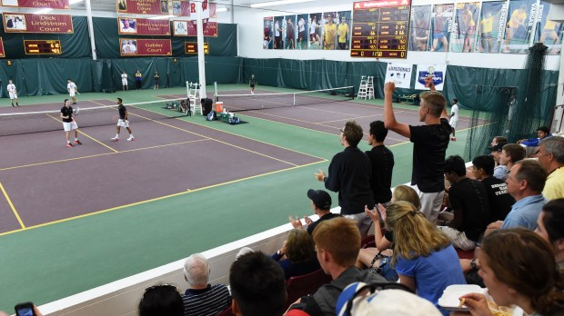 East Ridge tennis players cheer for their teamates during a doubles match of the Class 2A team semifinals during the State Boys' Tennis Tournament at Baseline Tennis Center in Minneapolis on Wednesday, June 7, 2017. (Scott Takushi Pioneer Press)