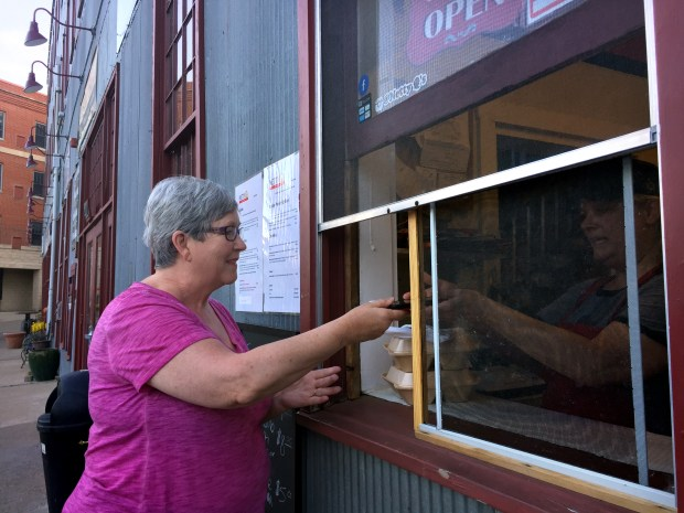 Jean Kubitschek of Stillwater orders from Lynette Bryant-Thompson at her new Italian walk-up Netty Q's in downtown Stillwater on June 1, 2017. (Nancy Ngo / Pioneer Press)
