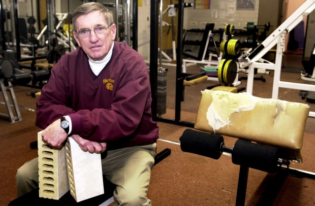 """Gerald Keenan, the athletic director at Harding High School, in the weight room at the school of Feb. 2, 2001. Keenan is spearheading the effort to build a new fitness center at the alma mater of the late St. Paul police officer Tim Jones, who was a standout athlete. Keenan and others have devised a plan to sell bricks in one of the new walls for $10 each. The equipment is old and the room is too small. He says that after school in sports seasons, the room is a mess with more than 40 students trying to work out. """"Safety becomes an issue, he said. """"And getting anything done in a too crowded room is an issue."""" (Pioneer Press / Jean Pieri)"""