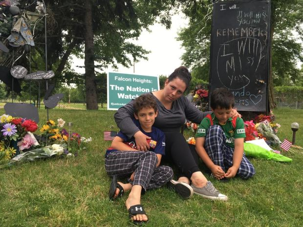 After the verdict on Friday, Kate Downing Khaled of St. Paul and her sons, Jibreel, 8 (left) and Esa, 7, came to the memorial site located near where Philando Castile died on Larpenteur near Snelling. (Molly Guthrey / Pioneer Press)