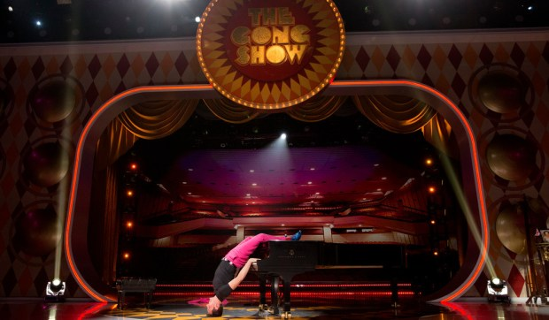 "Tom Franek of Northfield plays the piano upside down in the first episode of ""The Gong Show""reboot. The night's acts also include a unicycler – dressed in a yeti suit – playing flaming bagpipes, a married couple performing a choreographed banana spitting routine, a woman who plays the harmonica with a tarantula in her mouth, an obsessed fan who serenades judge Will Arnett with opera, and a scary wrestler who sings a children's lullaby. At the end of the show, the winning act with the highest judges' scores will receive a fabulous ""The Gong Show"" trophy and a check for $2,000 and 17 cents. (Courtesy of ""The Gong Show"")"