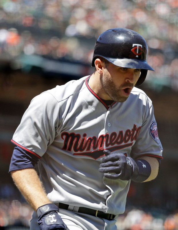 Minnesota Twins' Brian Dozier celebrates as he runs back to the dugout following his two-run home run against the San Francisco Giants during the fifth inning of a baseball game Saturday, June 10, 2017, in San Francisco. (AP Photo/Marcio Jose Sanchez)