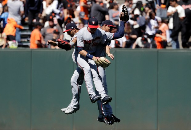 Minnesota Twins' Eddie Rosario, left, Max Kepler, center, and Byron Buxton celebrate after a win over the San Francisco Giants in a baseball game Saturday, June 10, 2017, in San Francisco. (AP Photo/Marcio Jose Sanchez)