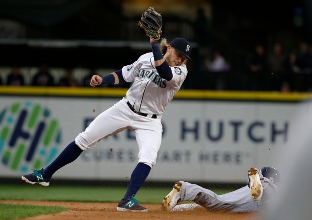 Seattle Mariners shortstop Taylor Motter, left, eyes second base as Minnesota Twins shortstop Ehire Adrianza steals the base during the fifth inning of a baseball game, Thursday, June 8, 2017, in Seattle. (AP Photo/Ted S. Warren)