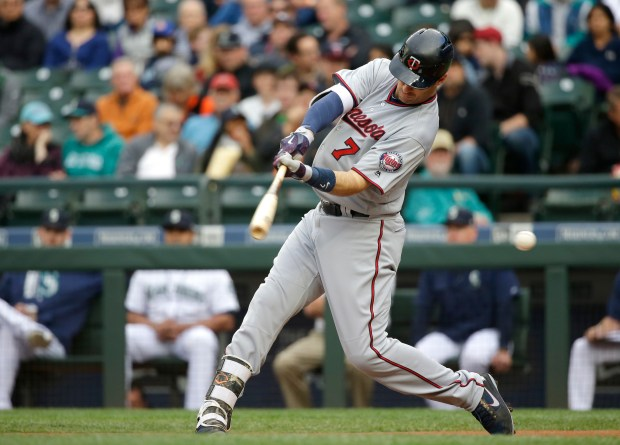 Minnesota Twins' Joe Mauer strikes out swinging during the first inning of the team's baseball game against the Seattle Mariners, Thursday, June 8, 2017, in Seattle. (AP Photo/Ted S. Warren)