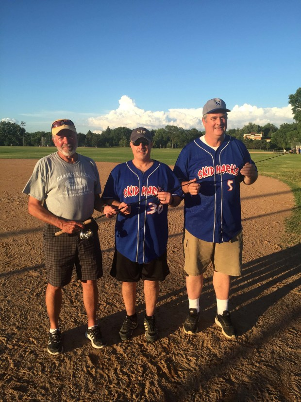 Al Stint, left, of Brooklyn Park, holds his fishing rod June 14, 2017 at Como Regional Park after being reunited with it by Dave Youngbauer, center, and Joe Harris. On May 14, Stint was fishing with the rod when it flew over the side, apparently stolen by a fish. Five days later, Youngbauer snagged the rod, which was attached to a 29-inch walleye, which Harris reeled in. (Courtesy of Joe Harris)