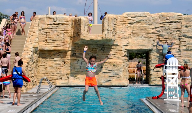 Samantha Lebret, 7, of St. Paul, jumps off the new zip-line at Como Regional Park Pool on Saturday, May 27, 2012. (Sherri LaRose-Chiglo / Pioneer Press)