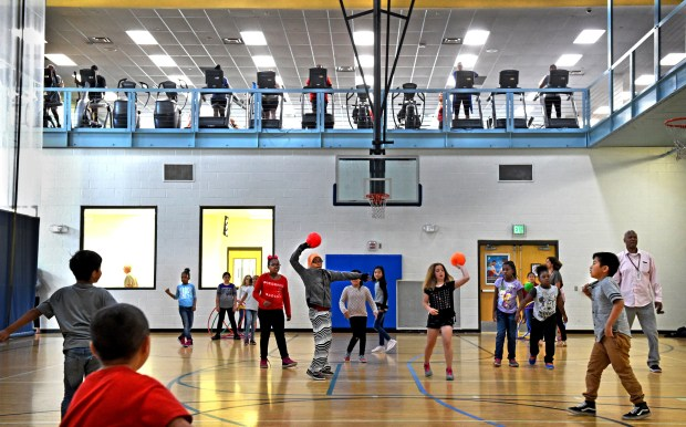 Students from John A. Johnson Elementary school play Castle Ball in a gym at the Greater Eastside YMCA in St. Paul on Wednesday, May 17, 2017. The school is connected to the YMCA and shares a program space to offer healthy and educational activities for the youth. (Jean Pieri / Pioneer Press)