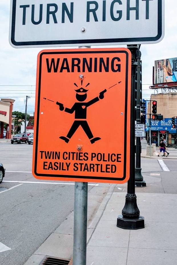 "An unofficial sign mounted Sunday, July 23, 2017, at Snelling Avenue and University in St. Paul warns that Twin Cities police are ""easily startled,"" an apparent response to recent police shootings. The sign was removed Sunday afternoon. (Courtesy of Addy Free)"