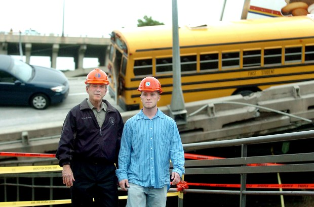 U.S. President George W. Bush, left, walks with Gary Babineau on the collapsed Interstate 35W bridge in Minneapolis on Saturday, Aug. 4, 2007. Babineau, a Blaine construction worker who received compression fractures in his vertebrae when his pickup fell with the bridge, helped save the 52 children who were in a schoolbus on the bridge when it fell. (Brandi Jade Thomas / Pioneer Press)