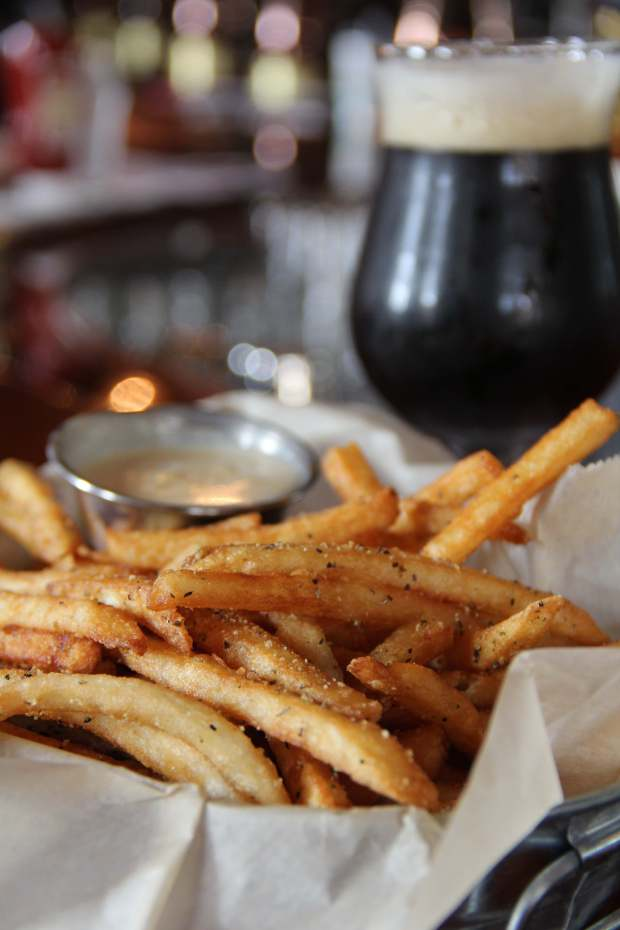 Fries and beer at HopCat. (Courtesy of HopCat)