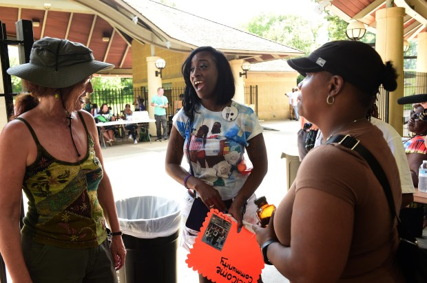 Diamond Reynolds, center, talks with friends and supporters Esther Benenson, left, of Minneapolis, and Arnetta Phillips of Maplewood at a community event on the one-year anniversary of the shooting death of Philando Castile in St. Paul's Como Park on Thursday, July 6, 2017. Reynolds, Castile's girlfriend, was in the car with Castile, a 32-year-old school cafeteria worker, when was shot to death by St. Anthony police Officer Jeronimo Yanez last July 6 during a traffic stop in Falcon Heights. She streamed the aftermath of the shooting live on Facebook. Yanez was acquitted of manslaughter last month in the case. (Scott Takushi / Pioneer Press)