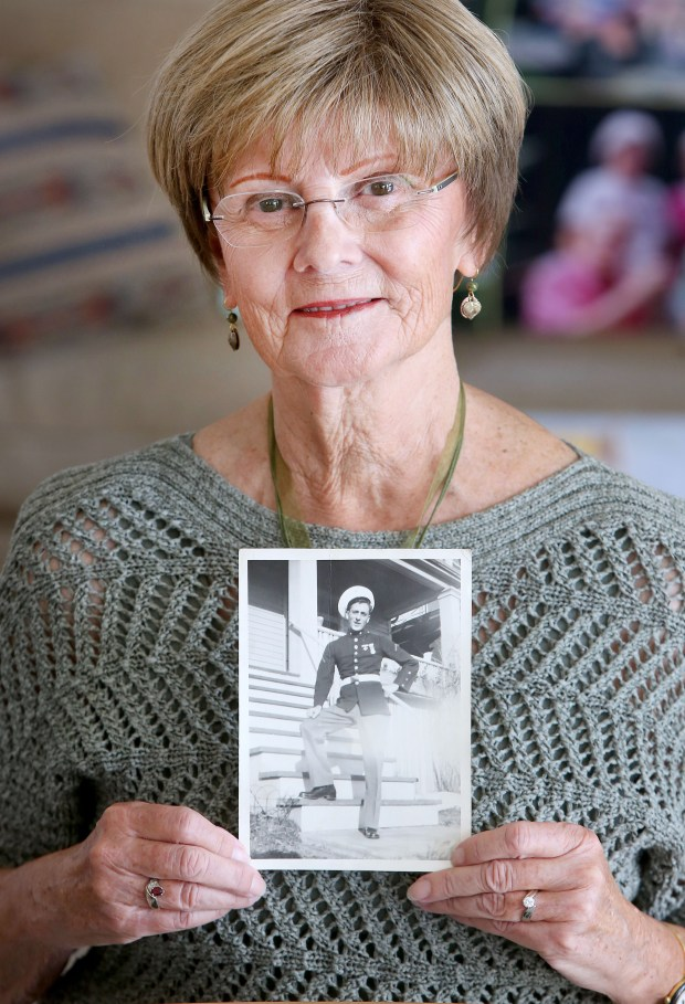 Mary Hagen of Duluth holds a photo of her brother James Hubert, a World War II vet who died in battle in the South Pacific Island of Tarawa, on May 11, 2017. Hubert was killed in action on Nov. 21, 1943, during the Battle of Tarawa. The Duluth resident was buried on the island of Betio, where his body remained unidentified for decades. Seventy-three years after he was killed, DNA testing identified his long-lost remains. He will be brought home to Duluth to be buried Saturday, July 15, 2017. (Bob King / Forum News Service)