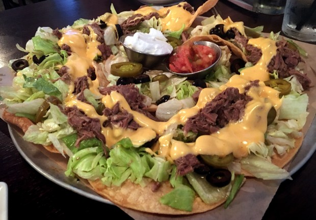 July 2017 photo of shredded beef nachos from Fitzgerald's on Cathedral Hill in St. Paul, part of a happy hour roundup for the July 26 Eat cover. (Jess Fleming / Pioneer Press)