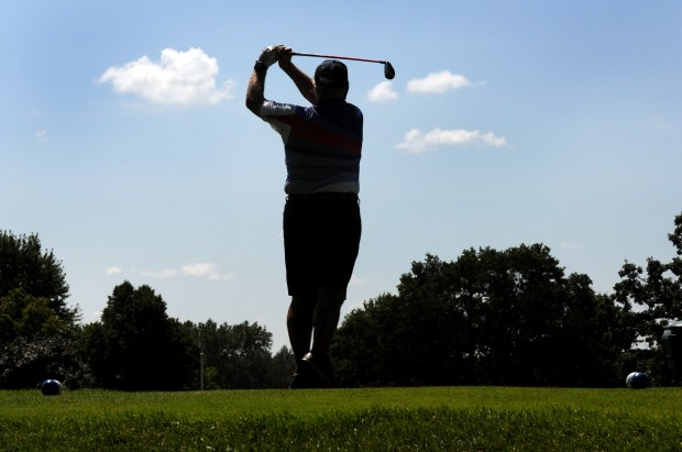 John Stoltenberg of Wayzata, Minn., finishes his swing after teeing off on the second hole at Hillcrest Golf Club in St. Paul Thursday, July 27, 2017. The 96-year-old course will close Oct. 31, owners have announced. (Dave Orrick / Pioneer Press)