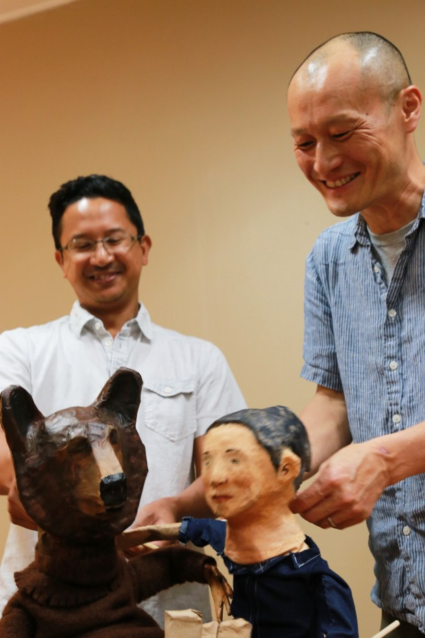 "Randy Reyes (left), Masanari Kawahari and some of the stars of ""Immigrant Journey Project."" (Mu Performing Arts)"