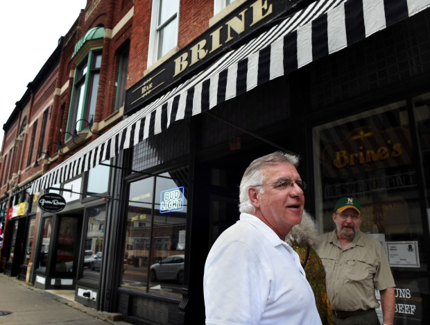 Brine's Restaurant & Bar in downtown Stillwater will be closing soon. Gerry Brine, who runs the bar and restaurant, is retiring in February. In this July 2017 photo, he gives directions to passersby in front of Brine's in Stillwater. (Jean Pieri / Pioneer Press)