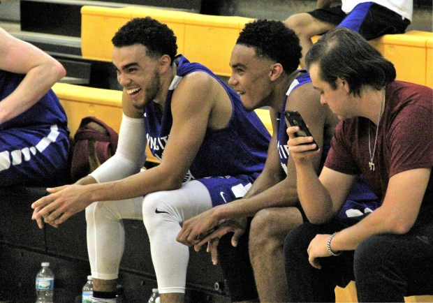 Tyus Jones, left, and his younger brother Tre laugh after their older brother, Jadee, scored during Team Jones' 99-91 win over Finer Way Inc. in a Twin Cities Pro-Am game at DeLaSalle High School in Minneapolis on Monday, July 10, 2017. (Jace Frederick / Pioneer Press)