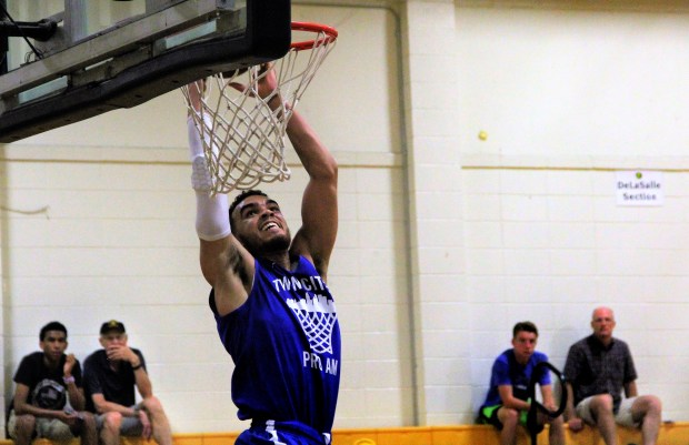 Tyus Jones finishes a lob from his younger brother, Tre, with a dunk during Team Jones' 99-91 win over Finer Way Inc. in a Twin Cities Pro-Am game at DeLaSalle High School in Minneapolis on Monday, July 10, 2017. (Jace Frederick / Pioneer Press)
