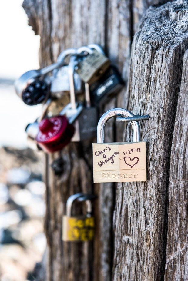 Chris Lewandowski and Shayna Derby's love lock hangs on a set of pilings along Lake Superior in Canal Park this winter. (Courtesy of Bryan Jonathan Weddings photo via Forum News Service)