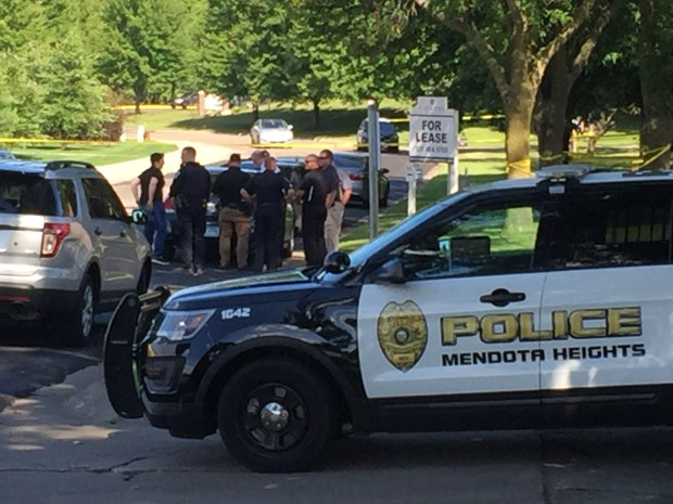 Police gather outside the Mendota Heights Business Center off Plaza Drive Saturday, July 29, 2017, during a manhunt for a man suspect.ed of killing a woman inside the building following a an armed robbery and police chase. (Will Ashenmacher / Pioneer Press)