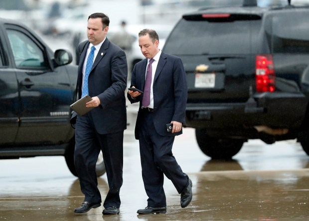 White House Director of Social Media Dan Scavino, left, walks with former White House Chief of Staff Reince Priebus as they arrive Friday, July 28, 2017, at Andrews Air Force Base, Md. Trump says Homeland Secretary Secretary John Kelly is his new White House chief of staff. (AP Photo/Alex Brandon)
